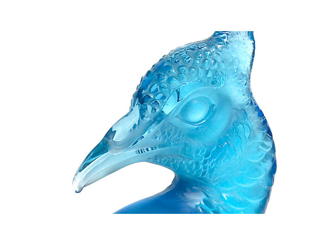 A René Lalique molded turquoise blue glass Tête de Paon car mascot Marcilhac 1140, design introduced 1928