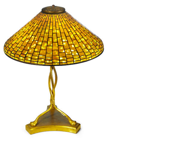 A Tiffany Studios Favrile glass and gilt-bronze geometric table lamp