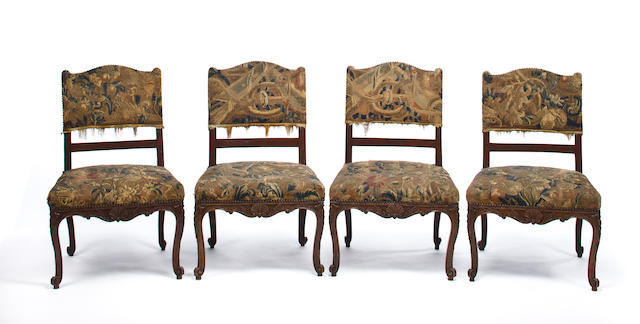 A set of four Louis XV tapestry upholstered side chairs