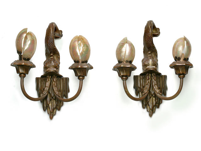 A pair of patinated bronze two light wall lights in the manner of Caldwell with Abalone shades