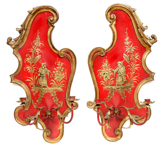 A pair of Baroque style red japanned and parcel gilt two light wall appliques 20th century