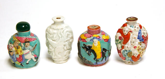 A group of four molded porcelain oval snuff bottles