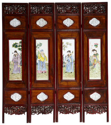 A four-panel screen with polychrome enameled porcelain plaques