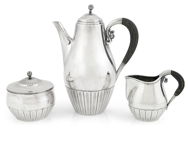 A Georg Jensen sterling silver 'Cosmos' three piece coffee service