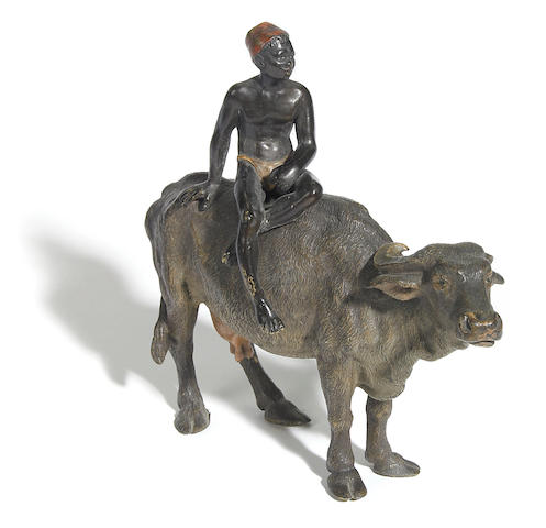 An Austrian cold painted figure of an Arab boy on water buffalo  circa 1900
