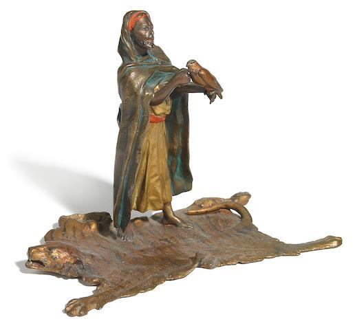 A Franz Bergman cold painted bronze figure of an Arab merchant on tiger skin rug  circa 1900