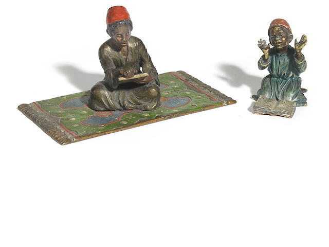 As Austrian cold painted bronze figure of an Arab boy reading on green rug  circa 1900