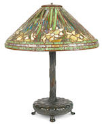 A Tiffany Studios patinated bronze and Favrile glass Daffodil lamp