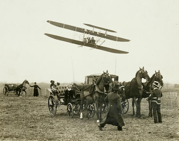 FROM CARRIAGES TO FLYING MACHINES. Black and white photograph,