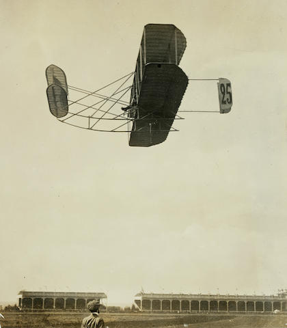 LEFEBVRE SOARS, CHAMPAGNE AIR RACE, 1909. Black and white photograph,