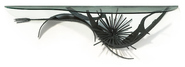 A sculpted steel and glass console in the manner of Silas Seandel, 1960s