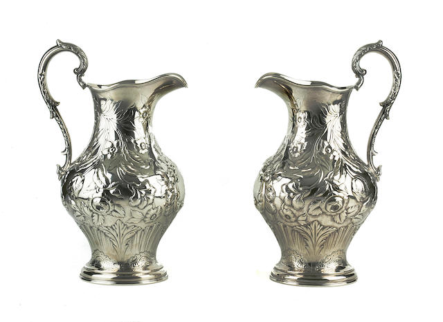 A pair of American coin silver pitchers Edgar Eoff for Ball, Tompkins & Black, New York, mid-19th century