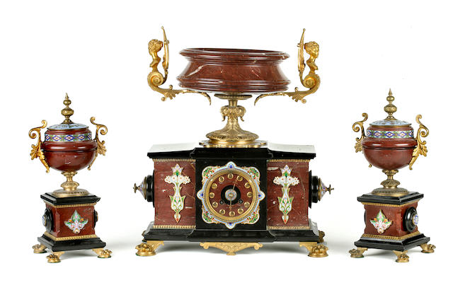 A cloissone, gilt bronze and marble clock garniture comprising a mantel clock surmounted by a large coup and two covered urns