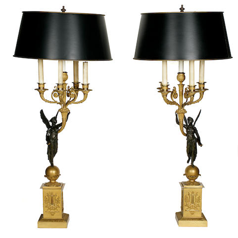 A pair of Empire style gilt and patinated bronze five light figural candelabra early 20th century