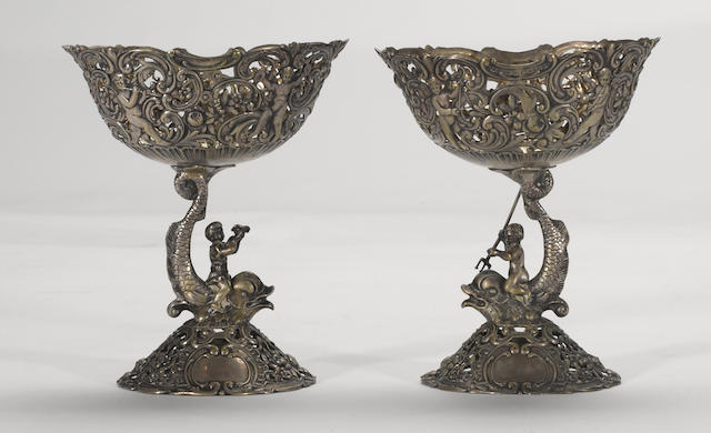 A German pair of 800 standard silver figural compotes, lacking glass fittings Hanau, circa 1900, possibly Gebruder Glaser