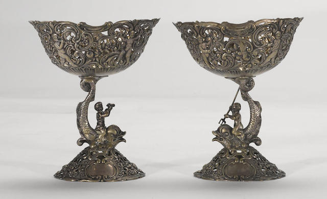A German pair of 800 standard silver figural compotes Hanau, circa 1900, possibly Gebruder Glaser