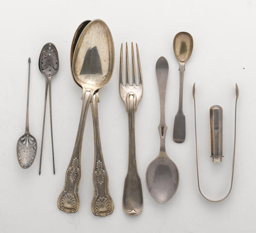 A group of miscellaneous English silver flatware with a pocket apple corer