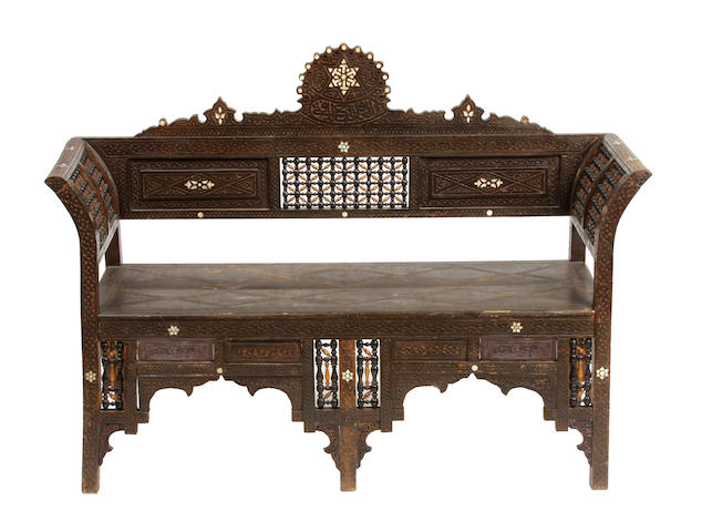 A Lenentine shell inlaid carved hardwood settee