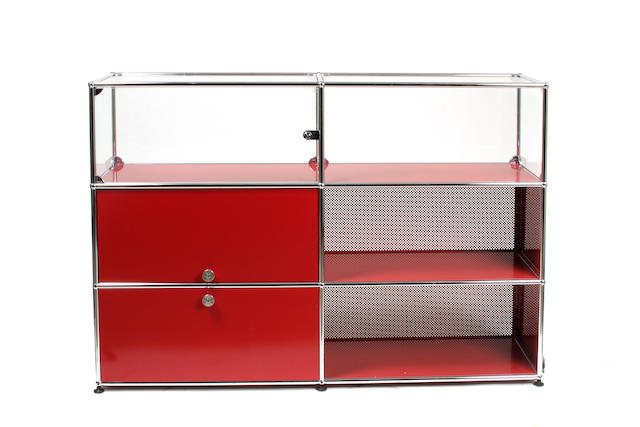 A Contemporary red enameled and chromed metal shelving unit
