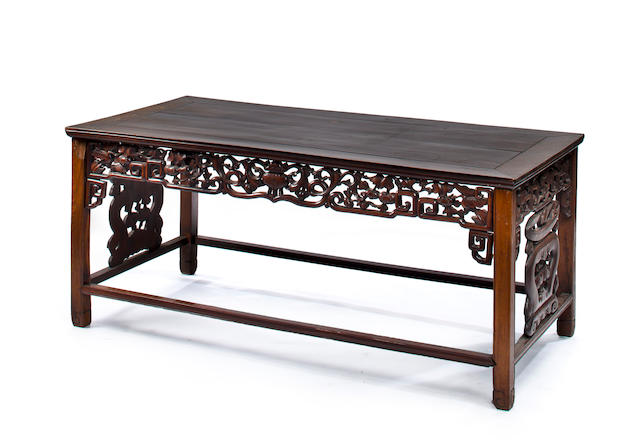 A Chinese Export carved wood serving table circa 1900