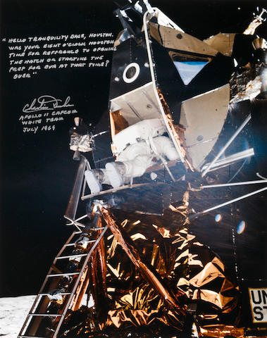 ALDRIN CLIMBS OUT OF THE HATCH. Color photograph,