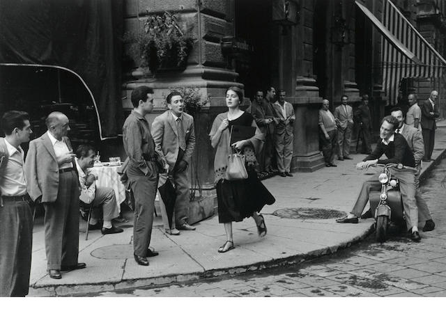 Ruth Orkin (United States, 1921-1985) American Girl in Italy, 1951, Gelatin silver print, 16 x 20 inches, Embossed stamp on recto; signed, titled & dated in pencil by Mary Engel (daughter) with the estate stamp on verso