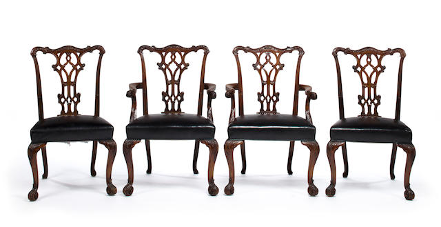 A set of eight George III style carved mahogany dining chairs