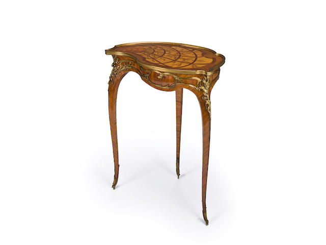 A Louis XV style gilt bronze mounted kingwood and marquetry cartouche shaped work table