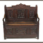 A Continental Baroque style oak settle