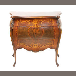 A Louis XV style marquetry inlaid walnut commode