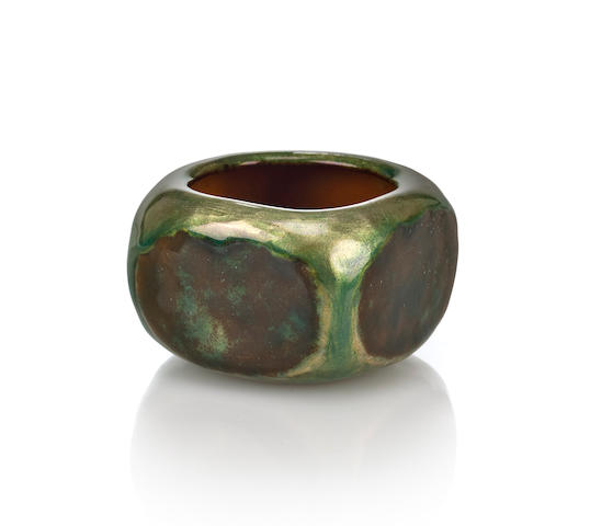 A Tiffany Studios enameled copper pot circa 1900