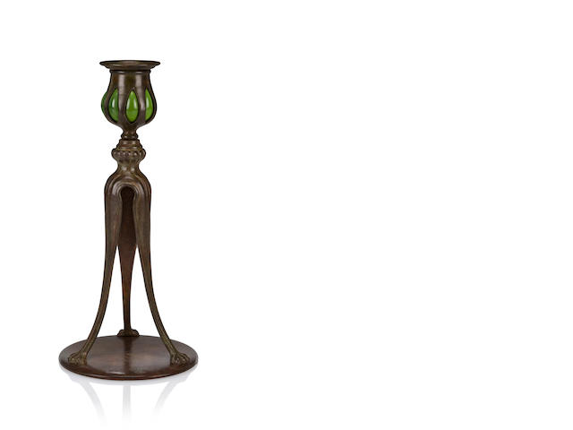 A Tiffany Studios three-legged candlestick