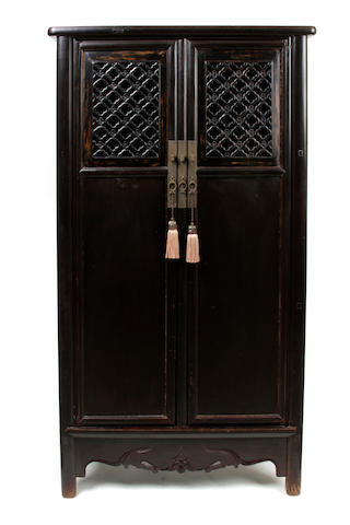 A Chinese hardwood cabinet with lattice work doors