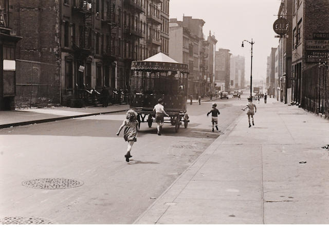 Helen Levitt (2), New York (kids and carousel), c. 1942, Gelatin silver print, 11 x 14 inches.  Signed & dated in pencil on verso  and  New York (boy with sprinkler truck), c. 1940, Gelatin silver print, 11 x 14 inches, Signed & dated in pencil on verso