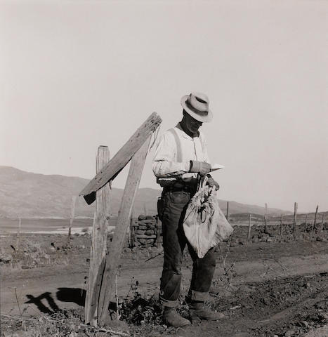 Dorothea Lange (American, 1895-1965) Farmer getting the morning mail, Genn County, Idaho, October 1939, Vintage gelatin silver print, Farmer Security Aministration, 10 x 8 inches.  Stamped by FSA on verso