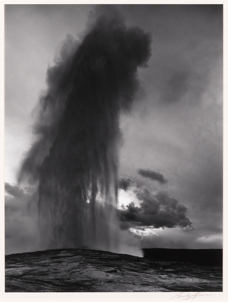 Ansel Adams, Old Faithful Geyser, Yellowstone National Park, Wyoming, 1941-1942/Printed 1950, Gelatin silver print 9 1/2 x 7 1/2 inches, mounted on a 18 x 14 archival mat.  Signed in pencil on recto, Edition 13/45