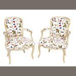 A pair of Louis XV parcel gilt and paint decorated fauteuils