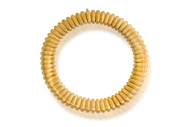 An eighteen karat gold necklace, Henry Dunay