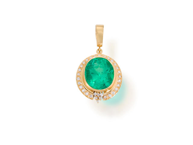 An emerald and diamond pendant enhancer