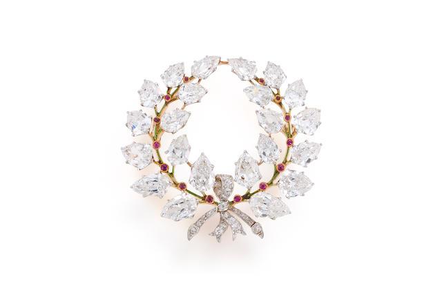 A diamond, ruby and enamel brooch