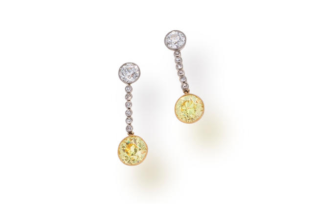 A pair of yellow diamond and diamond pendant earrings