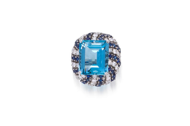 An aquamarine, diamond and sapphire ring