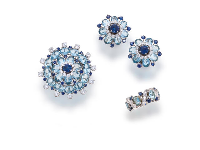 An aquamarine, sapphire and diamond brooch, earclips and a ring