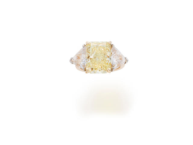 A fancy colored diamond and diamond ring