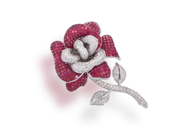 A pink sapphire and diamond brooch