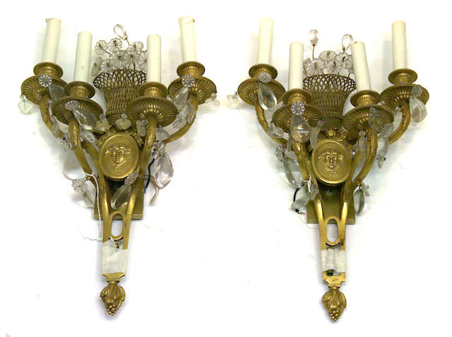 A pair of Louis XVI style bronze four light bras de lumière second quarter 20th century