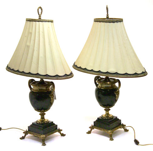 A pair of French Greek Revival gilt bronze and black slate two handle urns, now mounted as table lamps late 19th century