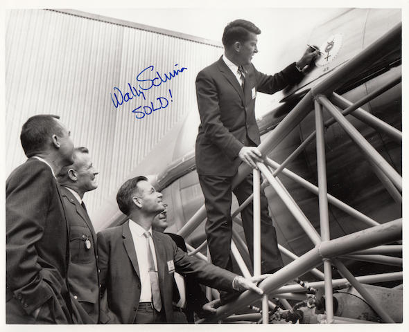 SCHIRRA BUYS AN ATLAS ROCKET! Black and white photograph,