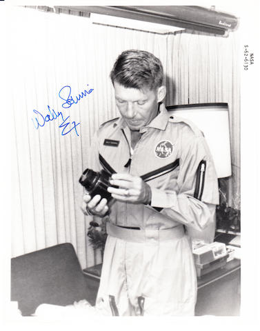SCHIRRA AND HIS HASSELBLAD FLIGHT CAMERA. Black and white photograph,