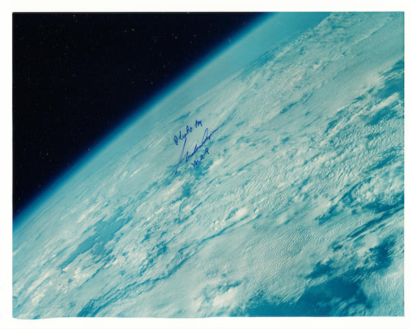 COOPER—PHOTOGRAPHER IN ORBIT. Color photograph,